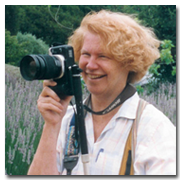 Photo of Marsha J Black in the field with her camera